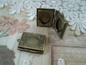bronze locket frames by butterbeescraps