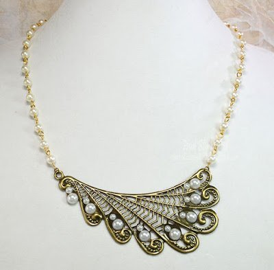 swirls and pearls wing necklace